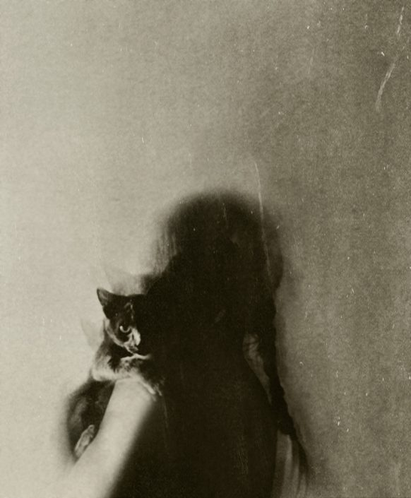 Woman holding a cat - Fine art photography by Alessandra Favetto